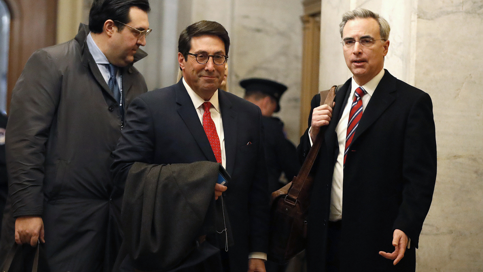 President Trump's personal attorney Jay Sekulow (center) stands with his son, Jordan Sekulow (left), and White House counsel Pat Cipollone in the Capitol on Saturday. (Julio Cortez/AP)