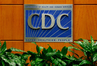 A podium with the logo for the Centers for Disease Control and Prevention at the Tom Harkin Global Communications Center in Atlanta.