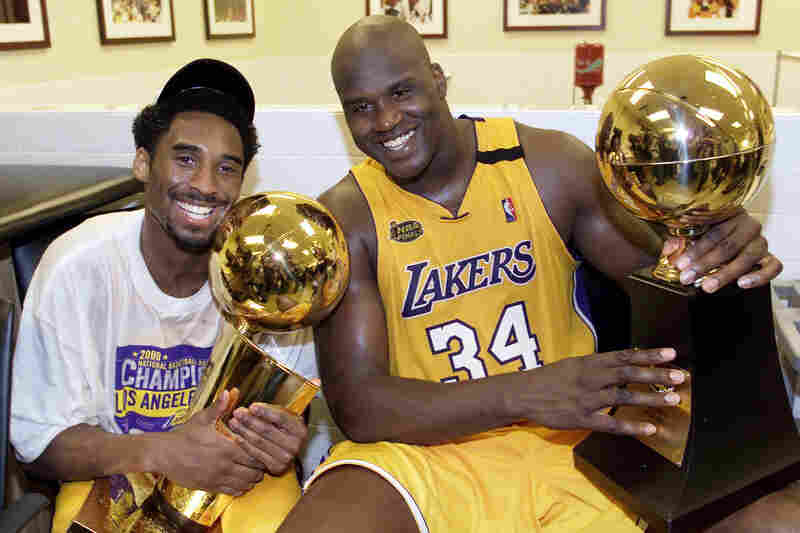 Bryant celebrates with Shaquille O'Neal after winning the NBA Championship against the Indiana Pacers on June, 19, 2000.