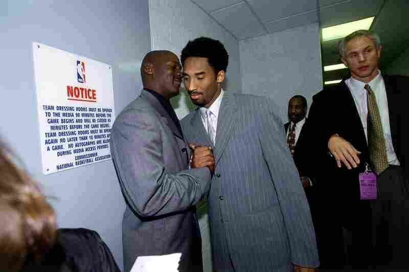 Bryant chats with Michael Jordan after a 2000 game at the Staples Center.