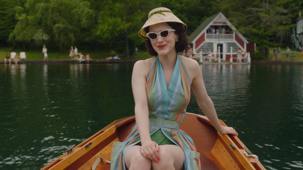 """In the second season of The Marvelous Mrs. Maisel, Midge (Rachel Brosnahan) visits the Catskills. Costume designer Donna Zakowska says this outfit """"in the boat with a funny lampshade hat"""" was among her favorites."""