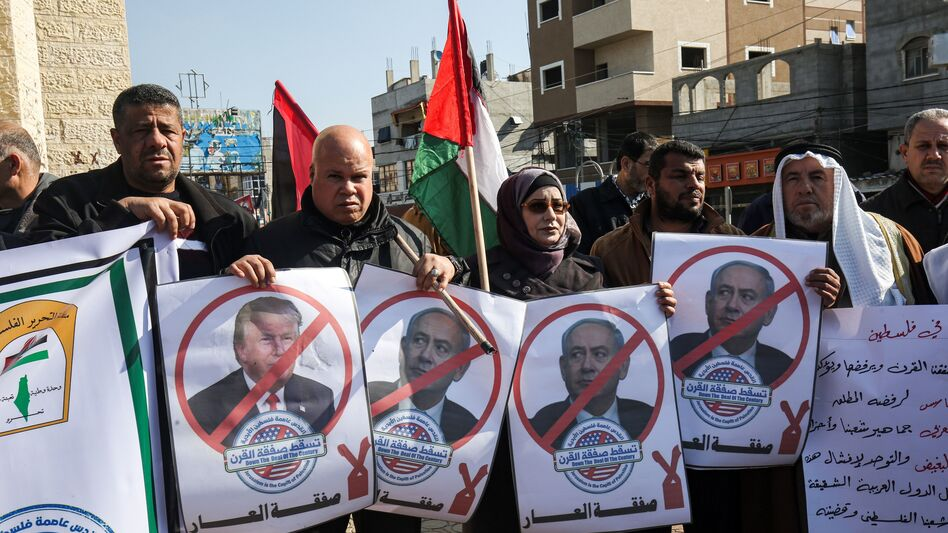 Palestinian demonstrators in Rafah, in the southern Gaza strip, hold portraits of President Trump and Israeli Prime Minister Benjamin Netanyahu during a protest against Trump's announcement of a peace plan on Tuesday. (Said Khatib/AFP via Getty Images)