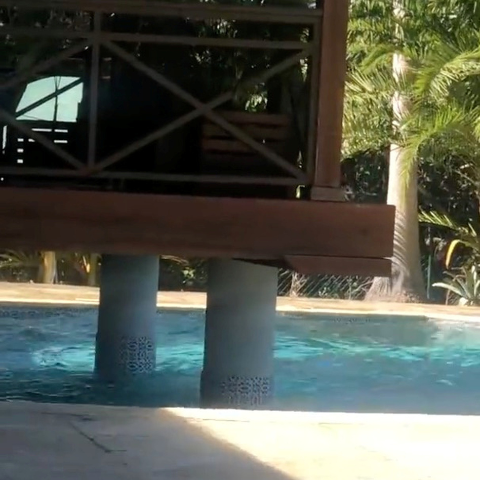Waves splash in a pool during an earthquake in the Cayman Islands. Social media was flooded with photos and video from people documenting the event. (Realvision.com via Reuters)