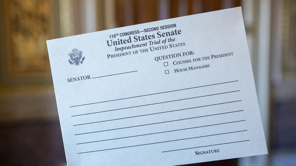 Senators are using these cards to hand-write their inquiries during President Trump's impeachment trial. The cards are passed up to Chief Justice John Roberts. (J. Scott Applewhite/AP)