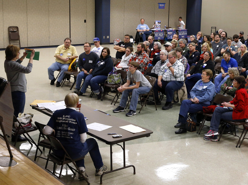 Voters listen to instructions during a Democratic Party caucus in 2016. The party has been under pressure to make the process more accessible this year, but some activists remain frustrated. (Patrick Semansky/AP)