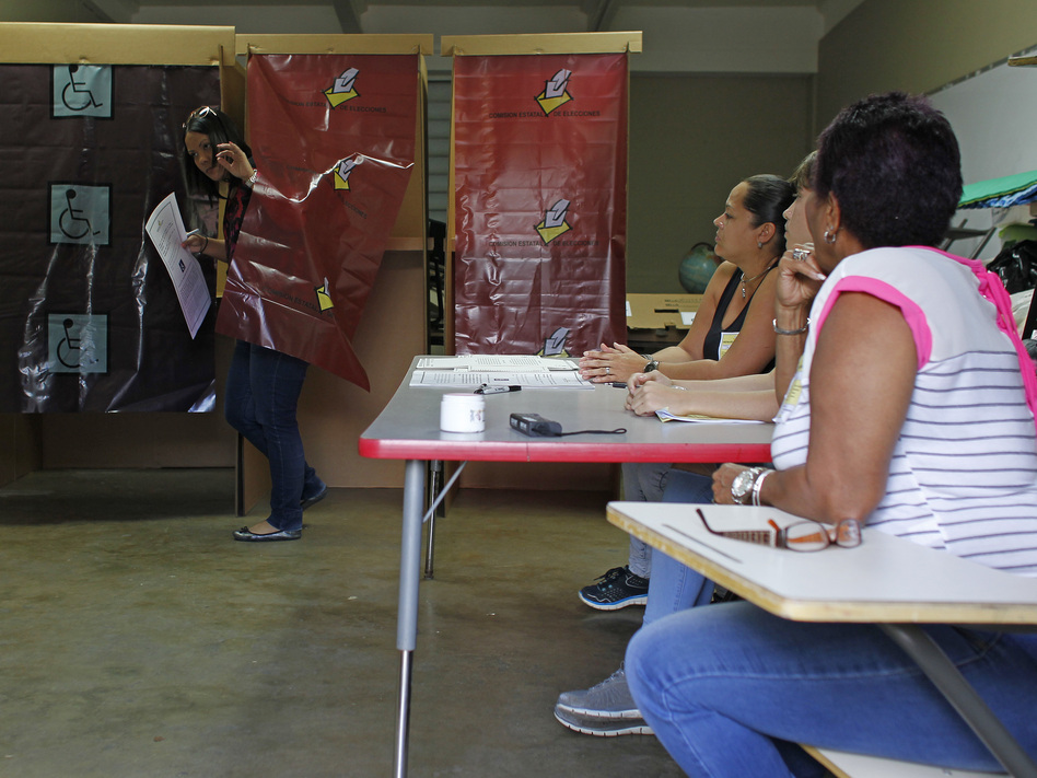 The ACLU is urging Puerto Rico's governor to veto a plan to introduce online voting on the island, warning it increases risks of election tampering. (Ricardo Arduengo/AFP via Getty Images)