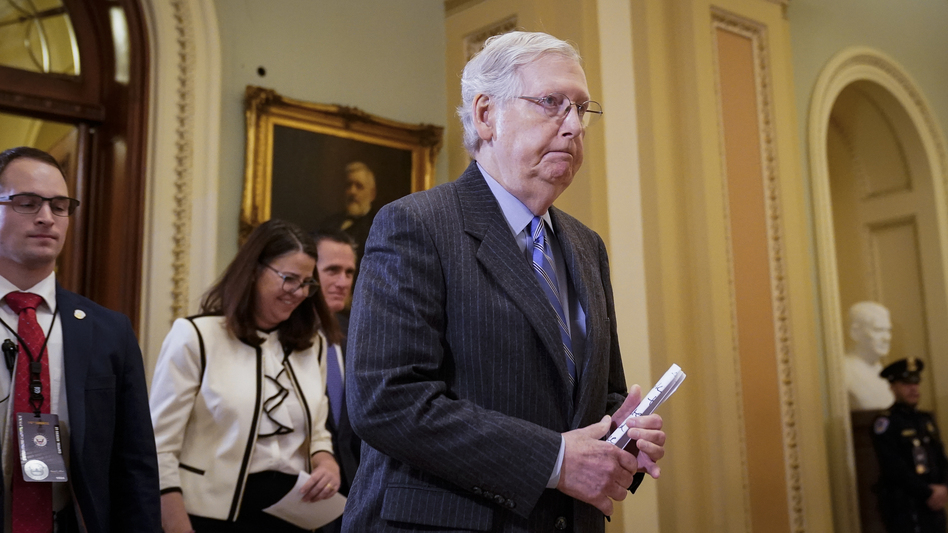 Senate Majority Leader Mitch McConnell, R-Ky., leaves the Senate chamber during a recess in the impeachment trial of President Trump on Friday. Senators voted against admitting witnesses and new evidence on Friday. (Drew Angerer/Getty Images)