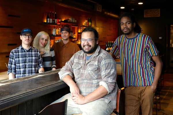 James Mark (center) inside his restaurant Big King, along with cooks (from left) Oscar Lange, Emily Joslyn, Peter Kachmarsky and JC Kuvaszko. Mark employs fewer than 50 people so isn't required to provide health benefits. But it helps with staff retention, he says, and is the right thing to do.