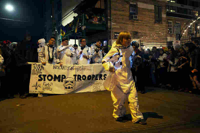 The STOMP Troopers, a sub-krewe for young people with autism, march down the street.