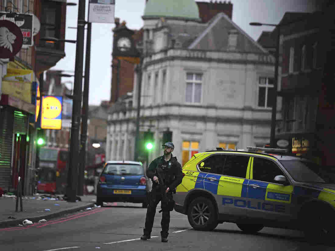 Man wearing fake bomb stabs 2 in London; shot dead by police