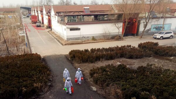 More than 20,000 people have been diagnosed with a new coronavirus in China since it was identified in December. Here, volunteers in protective suits deliver daily supplies to people who are under self-quarantine at a village in Shandong province, China.