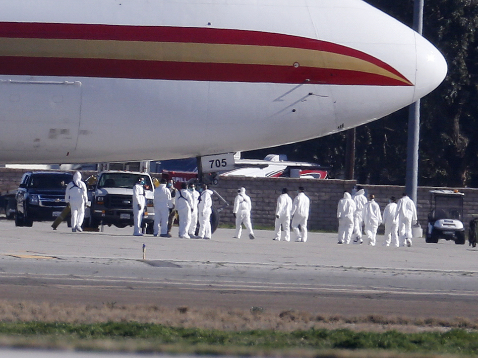 195 U.S. citizens who were evacuated from Wuhan, China, were placed in quarantine at March Air Reserve Base in Riverside County, Calif. New quarantine orders and travel restrictions intended to prevent the spread of coronavirus were announced Friday. (Ringo H.W. Chiu/AP)