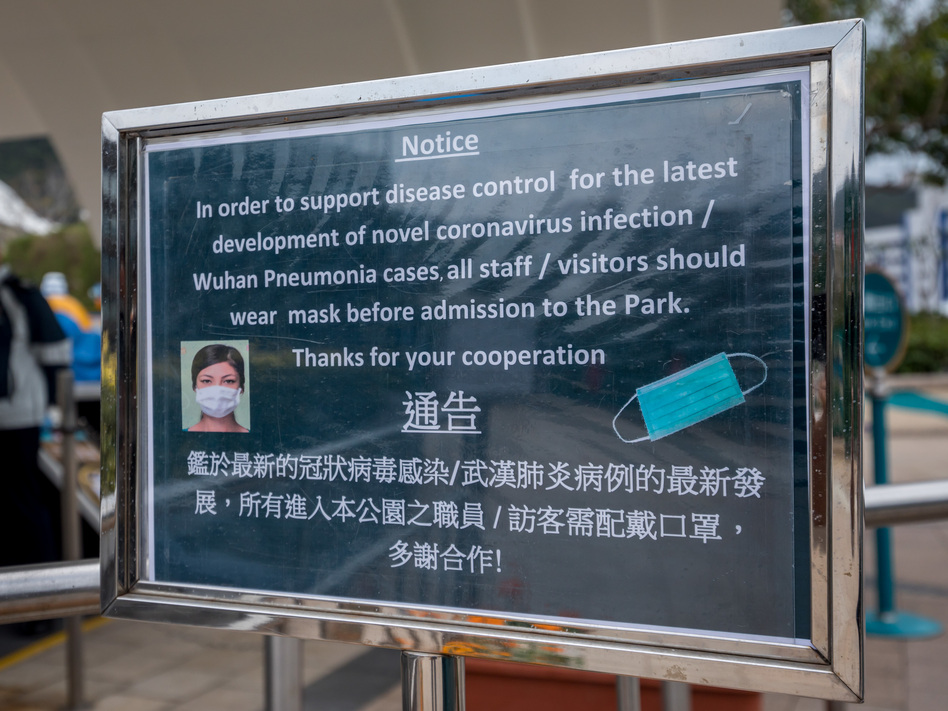 A notice advising all staff and visitors to wear protective masks stands outside the closed Ocean Park in Hong Kong, on Monday. (Paul Yeung/Bloomberg via Getty Images)