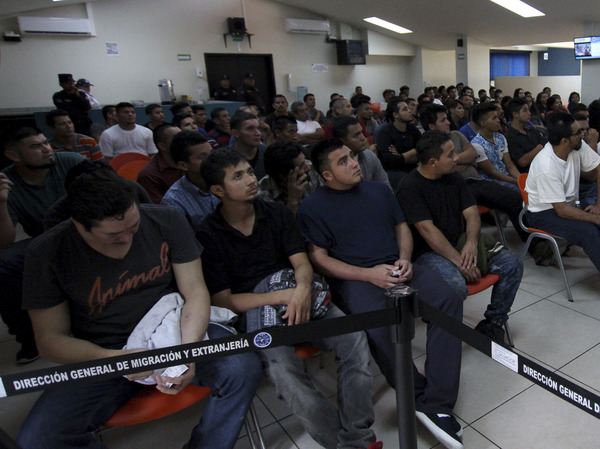 Salvadoran deportees, pictured in June 2018, listen to instructions from an immigration officer at La Chacra Immigration Center in San Salvador, El Salvador. A Human Rights Watch Report found that 138 repatriated Salvadorans have been killed since 2013. More than 70 others were beaten, sexually assaulted, extorted, tortured or went missing.