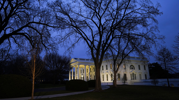 The White House stands at dusk on Wednesday evening after President Trump was acquitted on both articles of impeachment in the Senate trial.