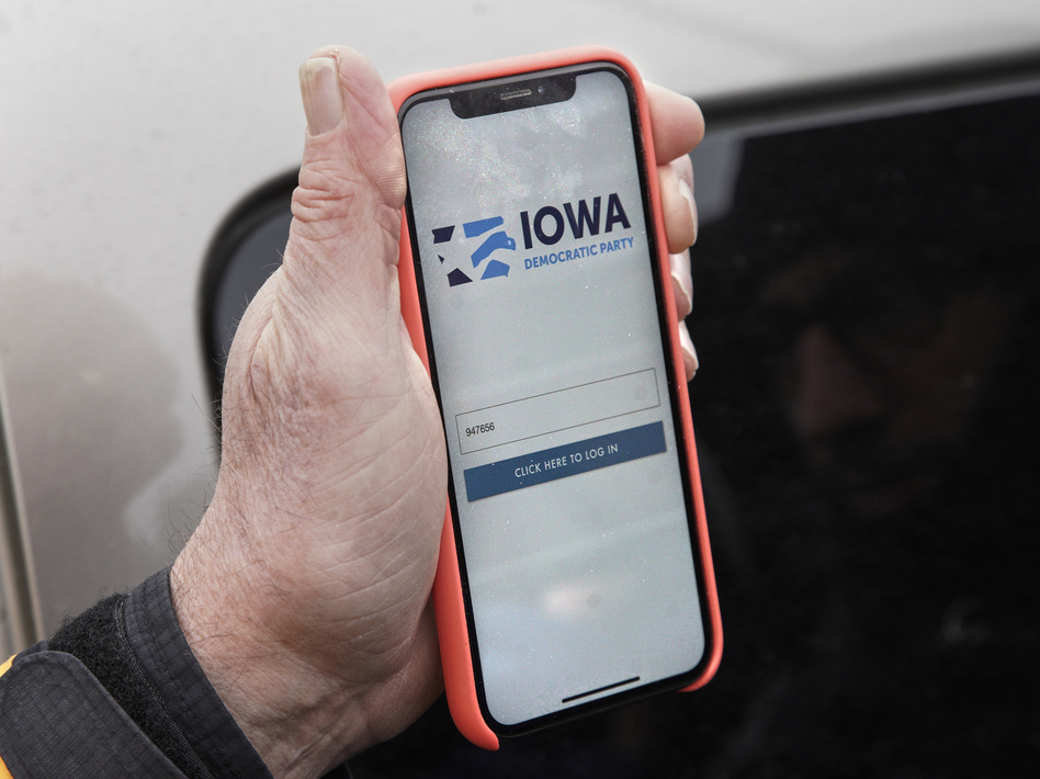 Precinct captain Carl Voss of Des Moines displays the Iowa Democratic Party caucus reporting app on his phone outside the Iowa Democratic Party headquarters on Tuesday. (Nati Harnik/AP)