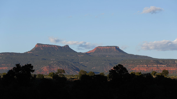 The two bluffs that inspired the name of the Bears Ears National Monument, seen at sunset outside Blanding, Utah. On Thursday, more than two years after the Trump administration announced plans to shrink the monument and others, federal managers have finalized the new land use plans.