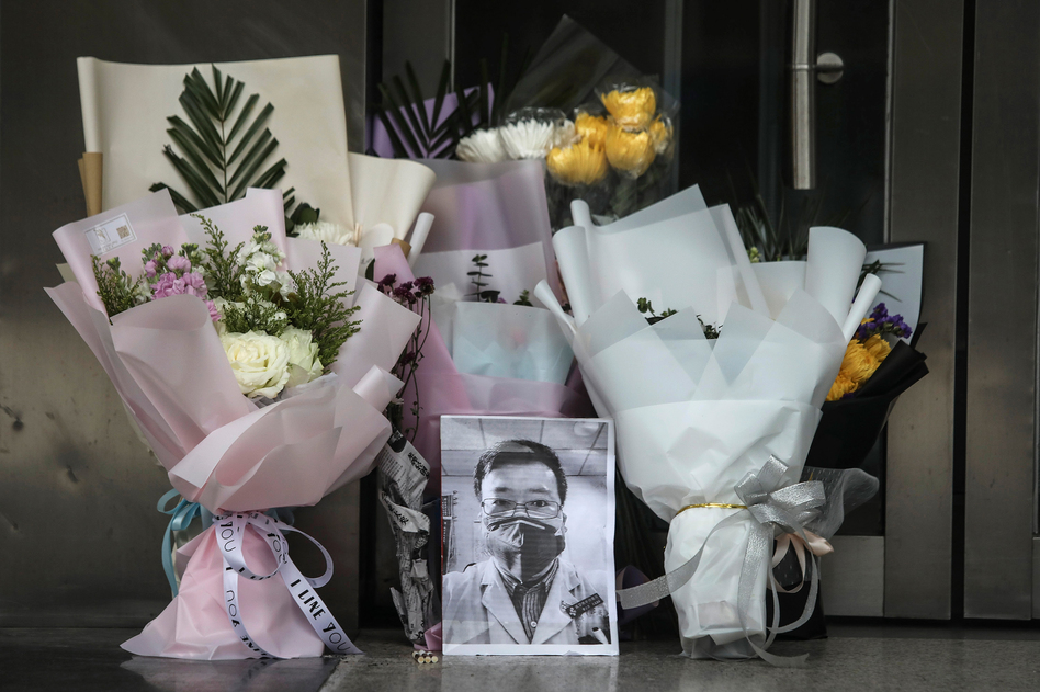 Flowers and a portrait of Dr. Li Wenliang is left at his hospital in Wuhan, China. Li, regarded a whistleblower in the coronavirus outbreak, died of the infectious disease on Friday. (Getty Images)