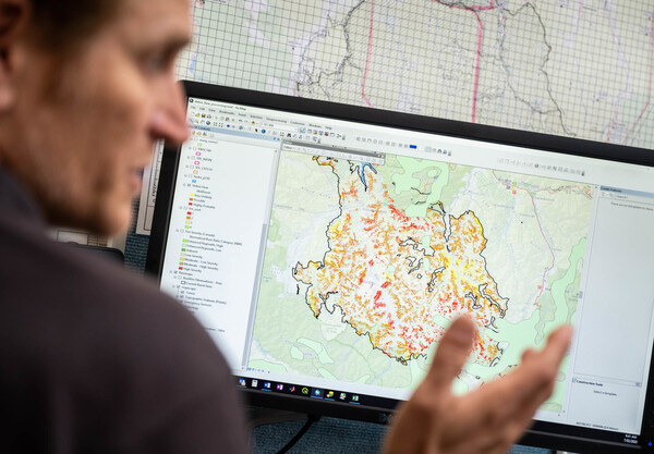 Showers, a groundwater geologist, is part of an assessment team that swoops into areas that have recently been burned by bushfires to map out where debris flows are most likely to happen. Red dots represent the highest likelihood of a debris flow event.