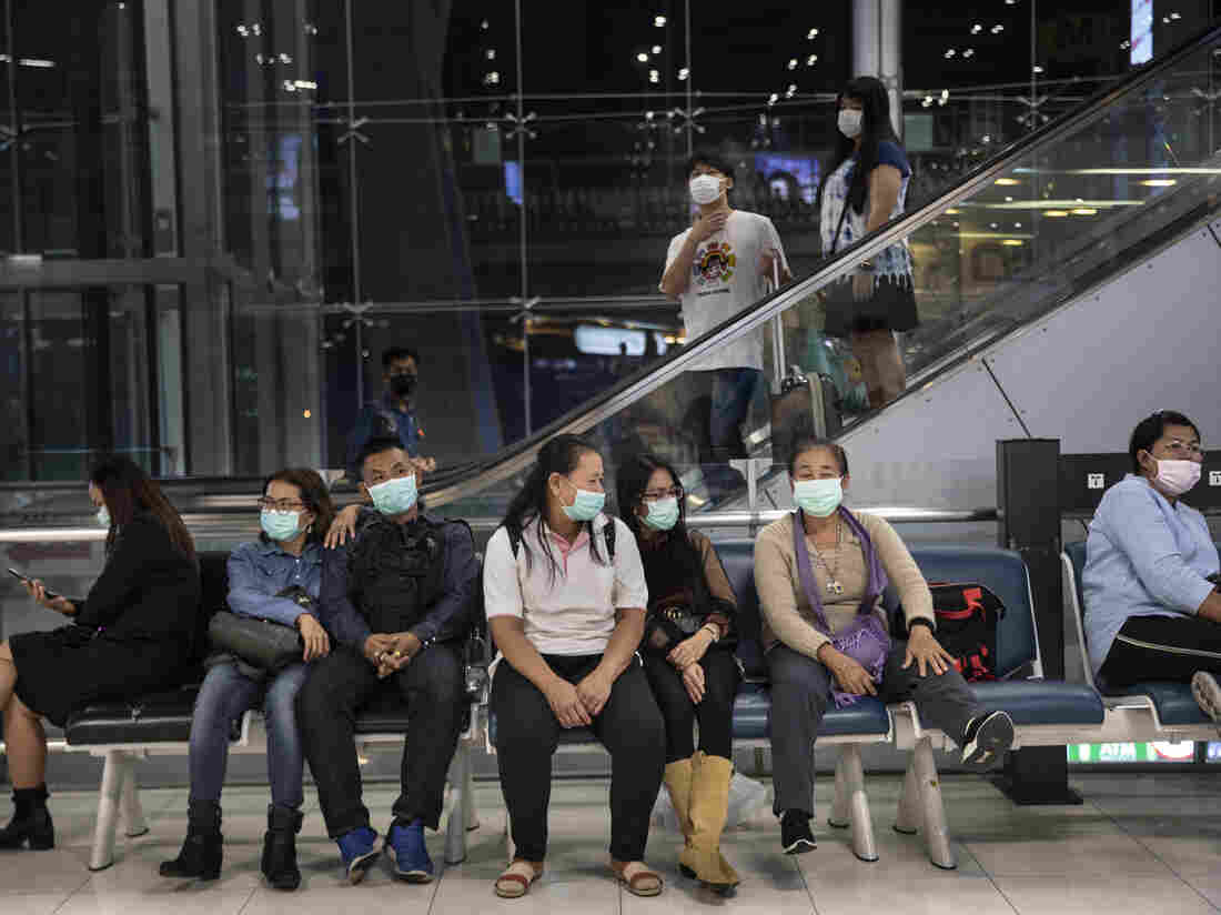 BANGKOK - FEBRUARY 10 : As Coronavirus spreads travelers arriving and departing wear masks at Suvarnabhumi International airport in Bangkok, Thailand (Photo by Paula Bronstein/Getty Images )