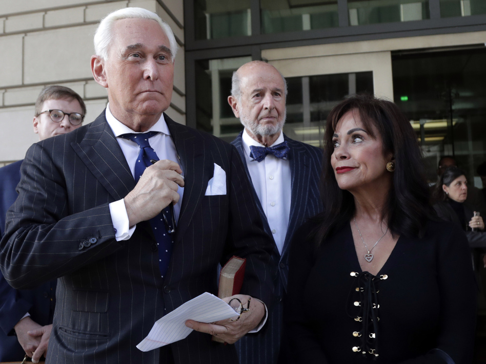 Roger Stone leaves federal court with his wife, Nydia Stone, on the day he was found guilty last fall. (Julio Cortez/AP)