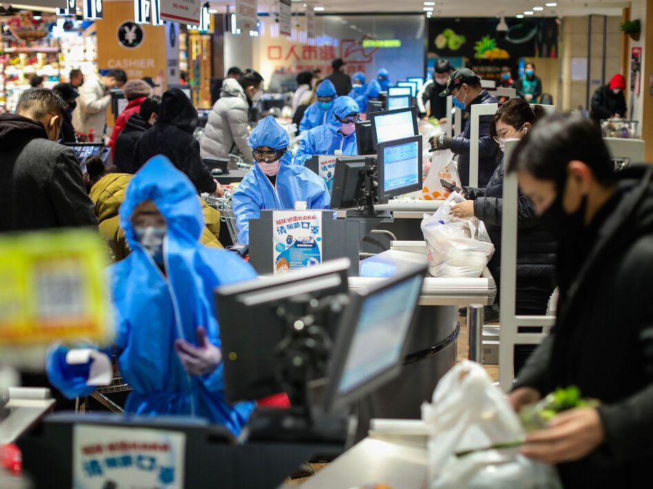 People wearing protective masks shopping at a supermarket in Shenyang in China's northeastern Liaoning province, on Monday. (AFP via Getty Images)