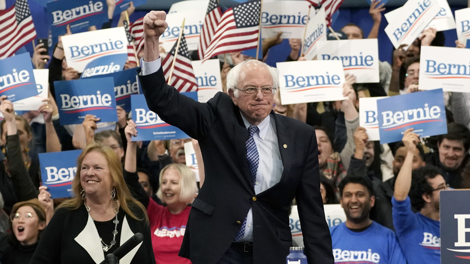 Sen. Bernie Sanders takes the stage during a primary night event on Tuesday in Manchester, N.H. His victory, projected by The Associated Press, comes in another close race with Pete Buttigieg. (Drew Angerer/Getty Images)