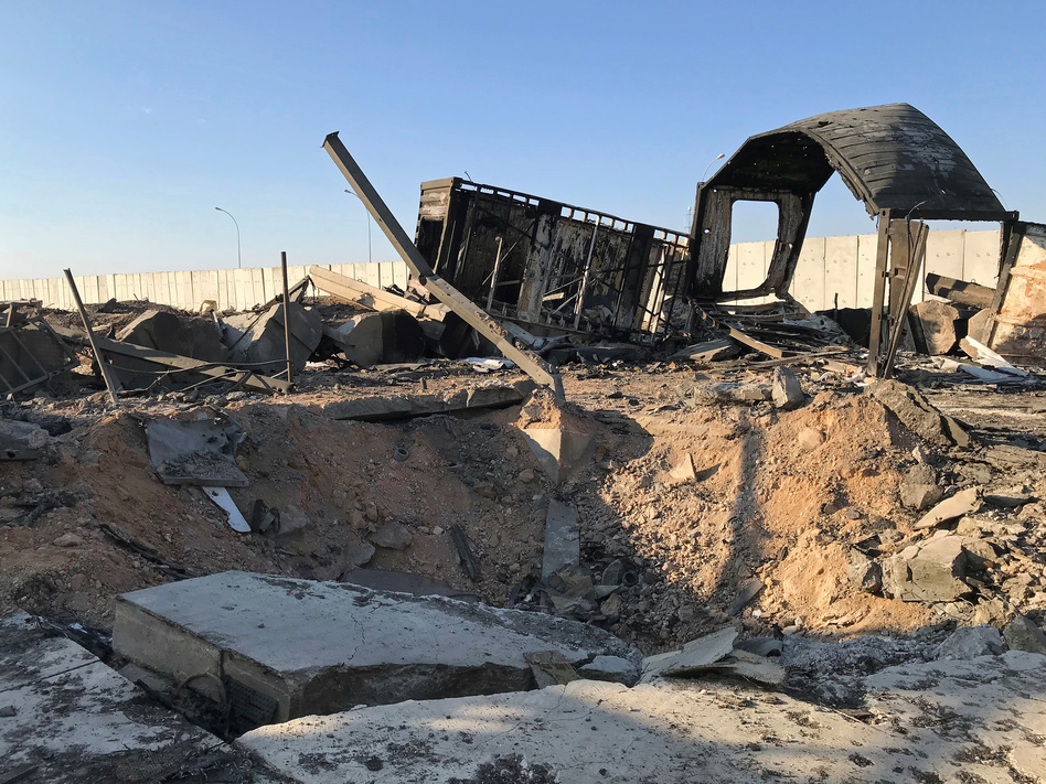 Debris and rubble are seen at the site where an Iranian missile struck Ain al-Asad air base in Iraq's Anbar province in January. The U.S. has repeatedly raised its injury report from the strike; it now says 109 personnel suffered brain injuries. (John Davison/Reuters)