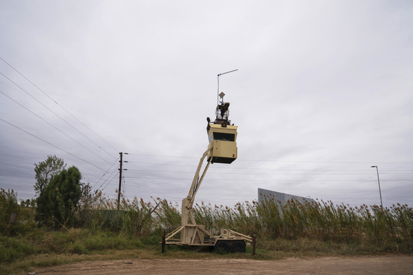 A surveillance tower is seen in Fred Cavazos' property yards away from the Rio Grande and the privately funded border wall in Mission, Texas.