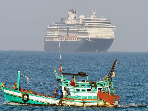 The MS Westerdam is seen with a local fishing vessel in the foreground as the cruise ship approaches the port of Sihanoukville on Cambodia's southern coast on Thursday.