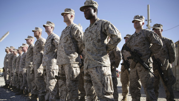 U.S. Marines stand guard during the change of command ceremony at Shorab military camp in Afghanistan