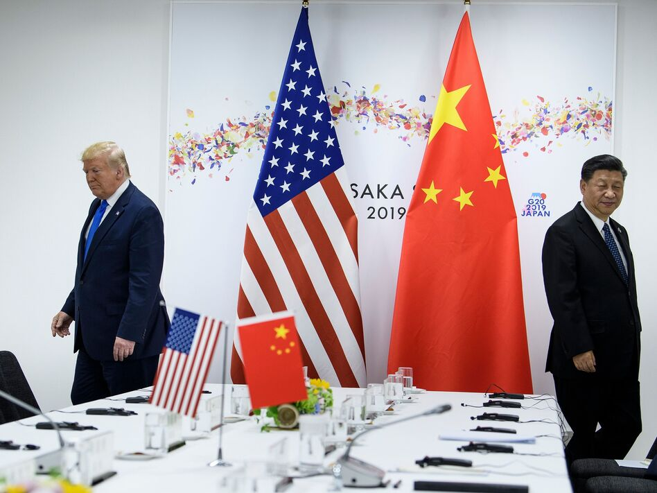President Trump and Chinese President Xi Jinping attend a bilateral meeting on the sidelines of the G20 Summit in Osaka last June. The two leaders spoke by phone earlier this month. Since the coronavirus outbreak, China has let in some experts from the World Health Organization but has not yet allowed in a team from the U.S. Centers for Disease Control and Prevention. (Brendan Smialowski/AFP via Getty Images)