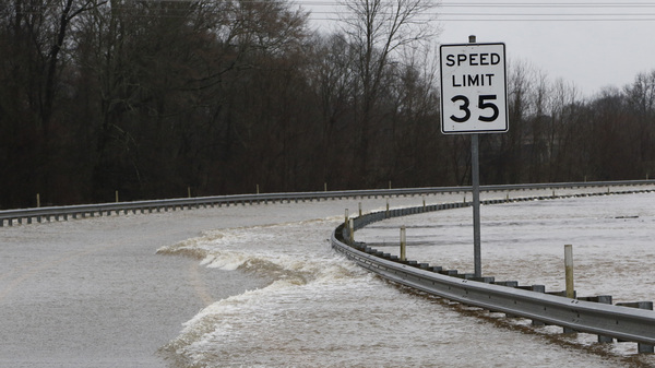 Strong currents from the swollen Pearl River flood over the Old Brandon Road Bridge in Jackson, Miss., on Sunday.