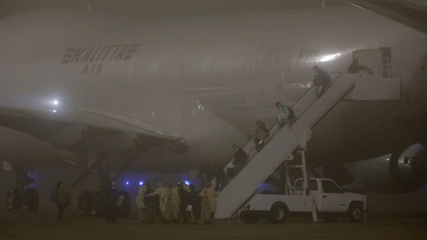 American evacuees from the Diamond Princess cruise ship arrive at Joint Base San Antonio-Lackland on Monday in San Antonio, Texas.
