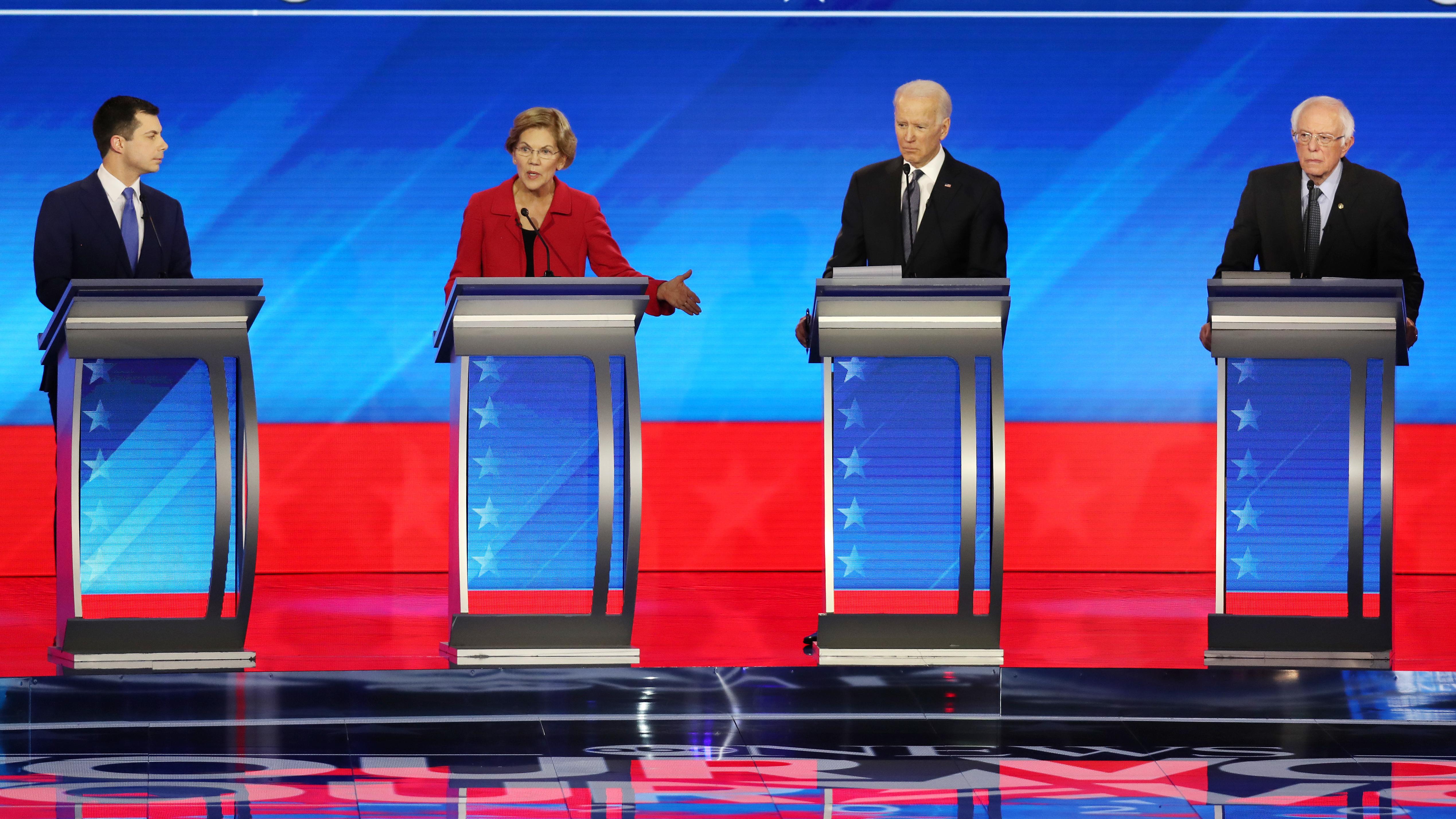 Amy Klobuchar and Michael Bloomberg join these four candidates — Pete Buttigieg (left), Elizabeth Warren, Joe Biden and Bernie Sanders — onstage Wednesday night.