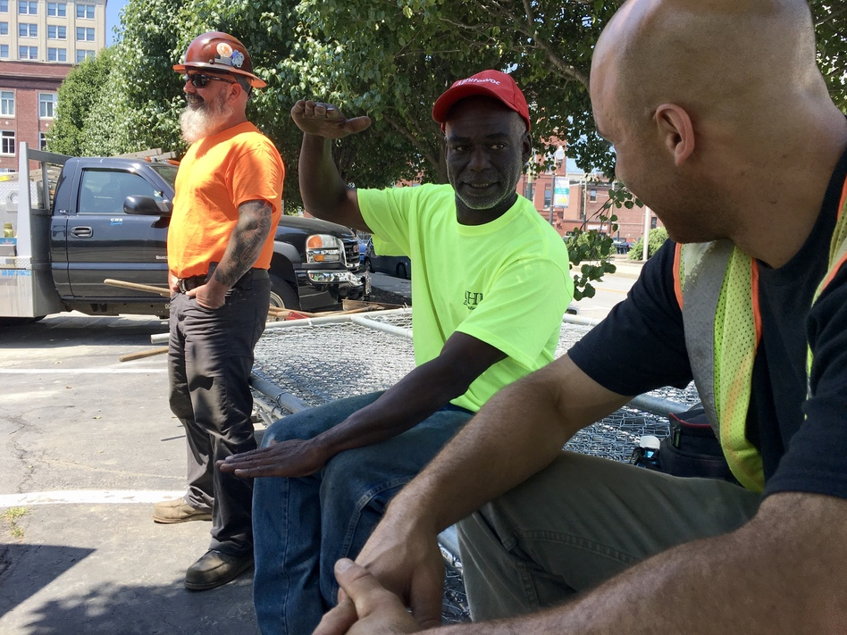 Calvin Brandford (center) is a certified minority contractor who has run an excavation business north of Boston for almost 30 years. Brandford said getting state-funded work as a subcontractor is very hard and often comes with a serious drawback: not getting paid for 60 to 90 days. (Chris Burrell/WGBH)