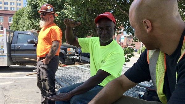 Calvin Brandford (center) is a certified minority contractor who has run an excavation business north of Boston for almost 30 years. Brandford said getting state-funded work as a subcontractor is very hard and often comes with a serious drawback: not getting paid for 60 to 90 days.