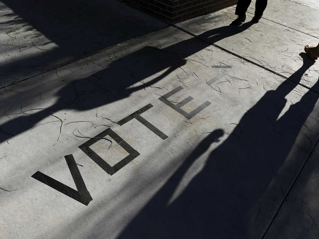 In this Nov. 6, 2018, photo, voters head to the polls at the Enterprise Library in Las Vegas. Nevada's Democratic Party announced new paper-based balloting for its early vote as it scrambles to reconfigure plans and avoid tech problems and reporting delays that mired Iowa's first-in-the-nation caucuses.