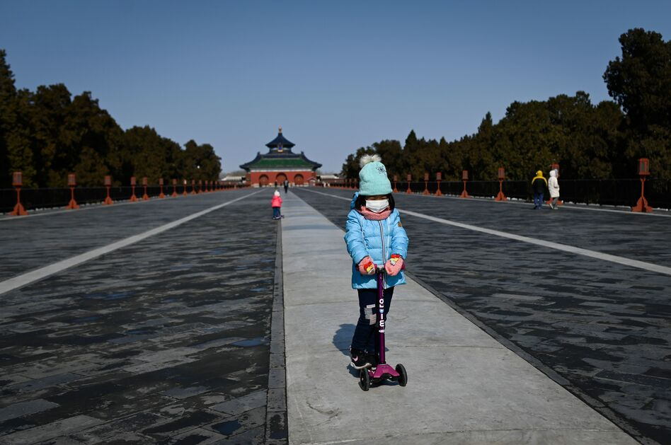 A girl in a park in Beijing on Feb. 15. Researchers are looking at the impact of the newly identified coronavirus on children. (Wang Zhao /AFP via Getty Images)