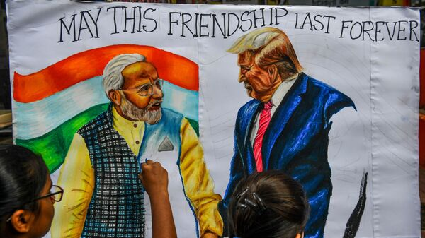 Students in Mumbai draw the likenesses of Indian Prime Minister Narendra Modi and President Trump, ahead of the U.S. president