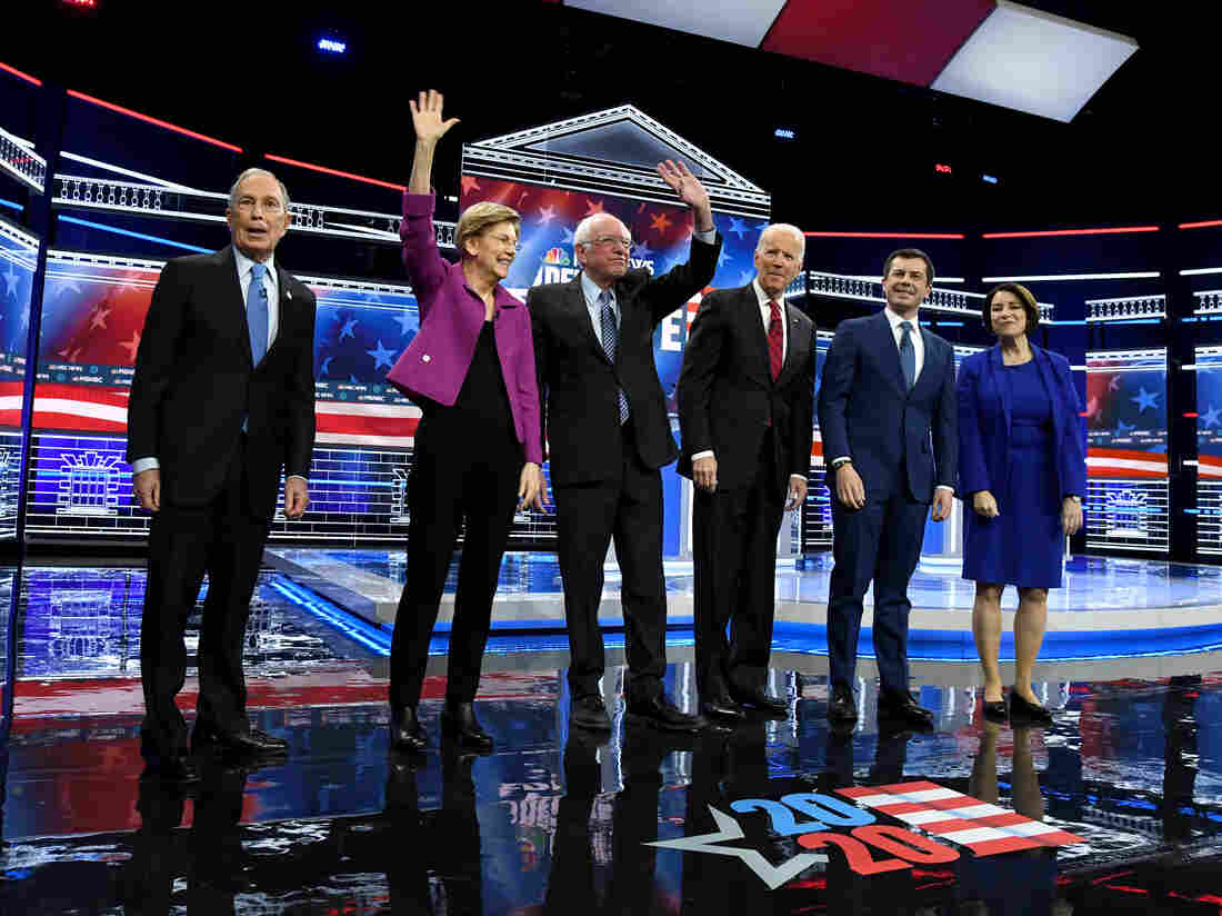 LAS VEGAS, NEVADA - FEBRUARY 19: Democratic presidential candidates stand onstage at the start of the Democratic presidential primary debate in Las Vegas, Nevada. (Photo by Ethan Miller/Getty Images)