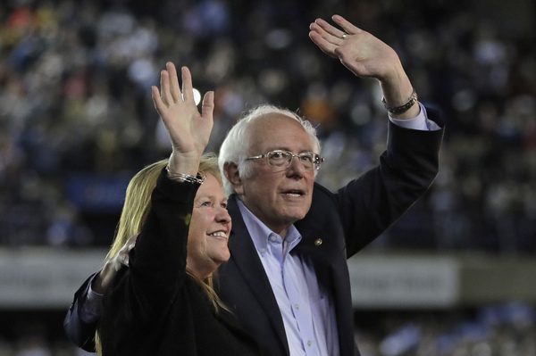 Democratic presidential candidate Sen. Bernie Sanders, I-Vt., waves with his wife, Jane, after his speech at a campaign event in Tacoma, Wash., on Feb. 17.