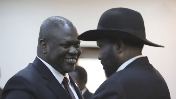 Riek Machar (left) shares a smile with South Sudan's president, Salva Kiir, after a swearing-in ceremony Saturday in the capital, Juba. Observers hope their newly forged coalition spells an end to civil war.