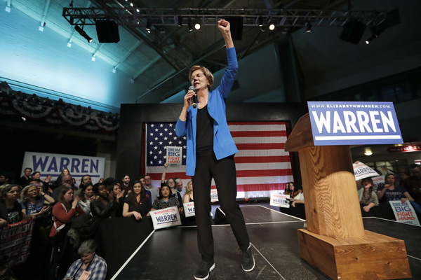 Sen. Elizabeth Warren makes a fist during a campaign event in Seattle. Washington state holds its nominating contest March 10, a week after Super Tuesday.
