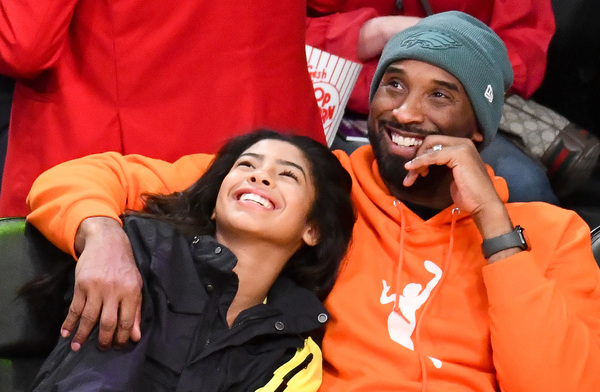 Kobe Bryant and daughter Gianna Bryant attend a basketball game between the Los Angeles Lakers and the Dallas Mavericks on Dec. 29, 2019 in Los Angeles.