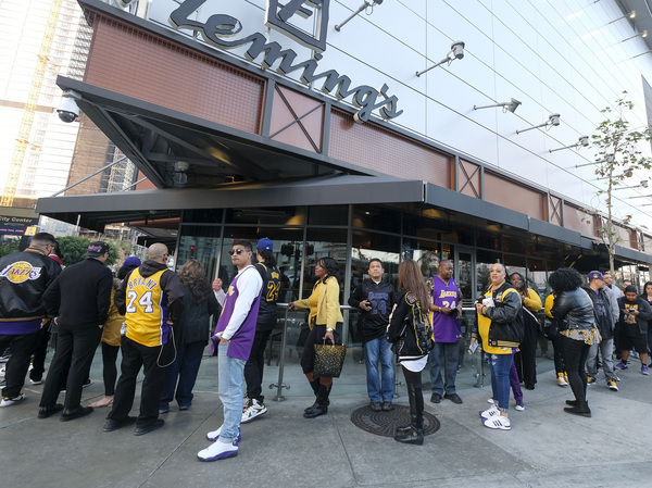 Fans line up to get into the Staples Center to attend a public memorial for former Los Angeles Lakers star Kobe Bryant and his daughter, Gianna, in Los Angeles.