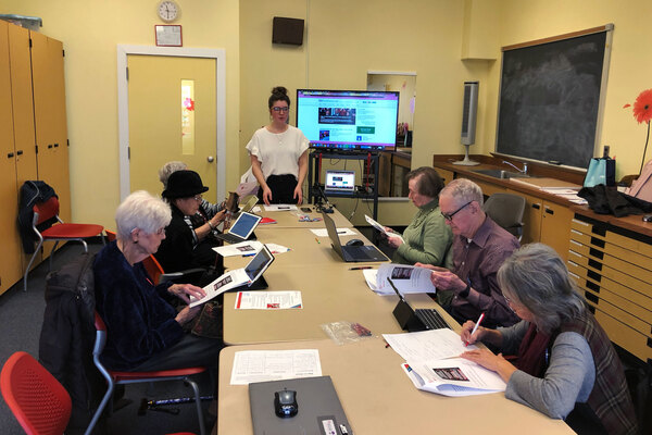 Bre Clark leads a workshop at the Schweinhaut Senior Center in Silver Spring, Md., called How to Spot Fake News.