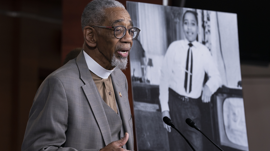 Rep. Bobby Rush, D-Ill., speaks during a news conference about the Emmett Till Antilynching Act on Wednesday on Capitol Hill. He stands beside a photo of Emmett Till, a 14-year-old African American who was lynched in Mississippi in the 1950s. (J. Scott Applewhite/AP)