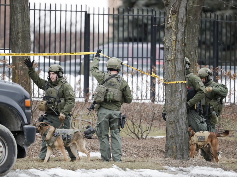 Police respond to reports of an active shooting at the Molson Coors Beverage Co. campus in Milwaukee on Wednesday. Police said the shooter was a 51-year-old Milwaukee man. (Morry Gash/AP)