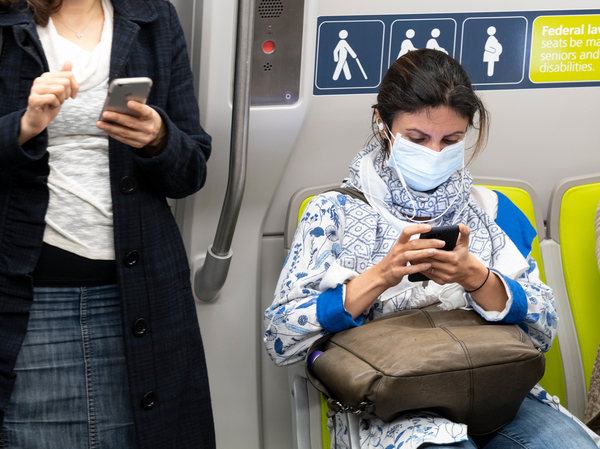 Health officials have identified what could be the first U.S. case of the novel coronavirus spreading within the general population. But a hospital says the diagnosis was delayed for days. Here, a passenger wears a face mask on a train in San Francisco Wednesday.